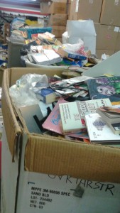 7 containers of donated, unsorted books!